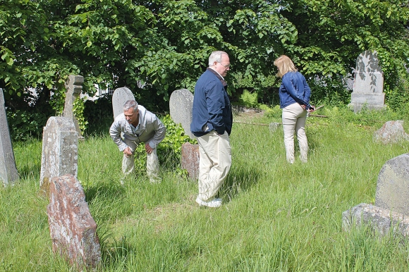 Dale and Anita Galbraith searching for Galbraith stones with Dale's brother